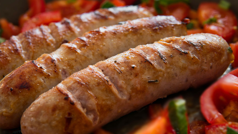 Sausages Braised with Cider and Smoky Bacon Recipe