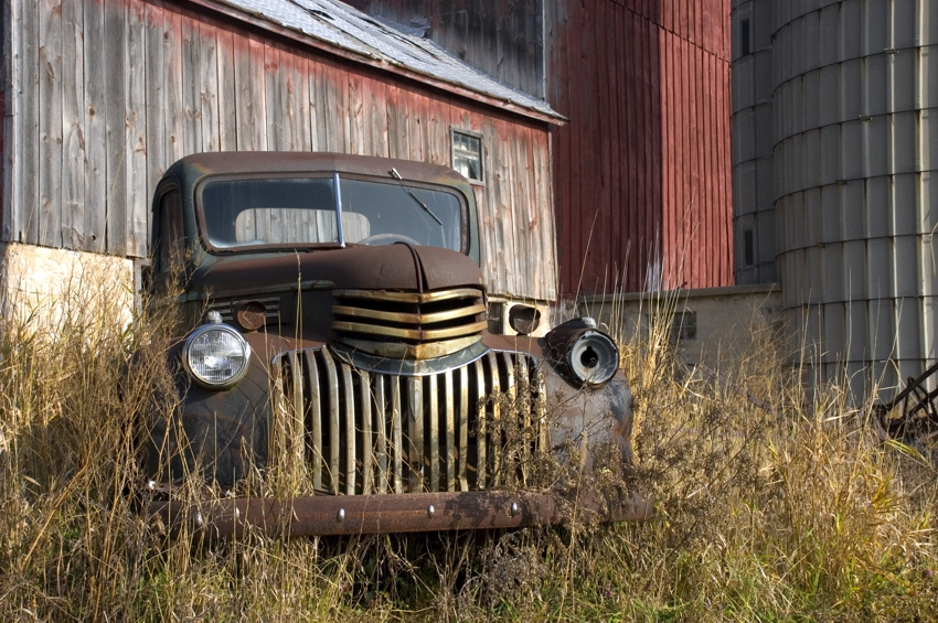 family farm, antique truck in weeds on farm