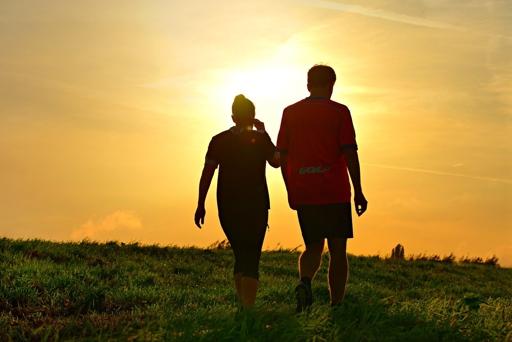 man and woman walking, muscle loss