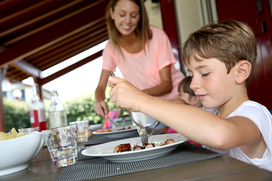 mom serving children grilled meat, behavior problems, learning difficulties